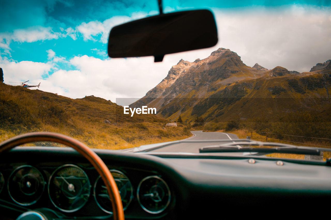Mountains Seen Through Windshield