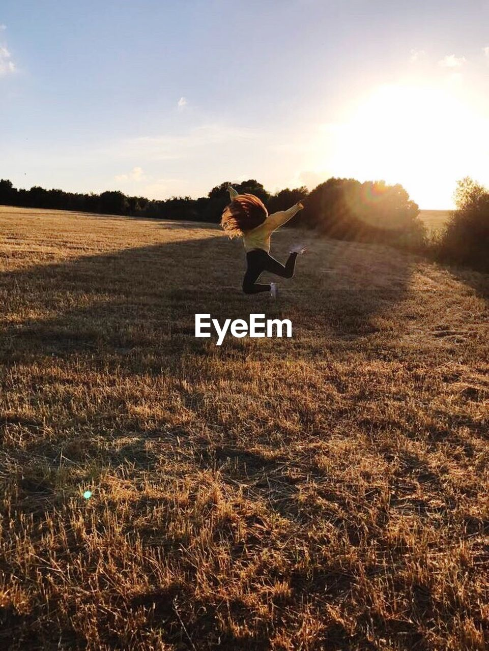 one person, one woman only, sunset, grass, only women, full length, field, one young woman only, adults only, adult, young adult, nature, young women, women, outdoors, people, day, sky, flexibility, beauty in nature