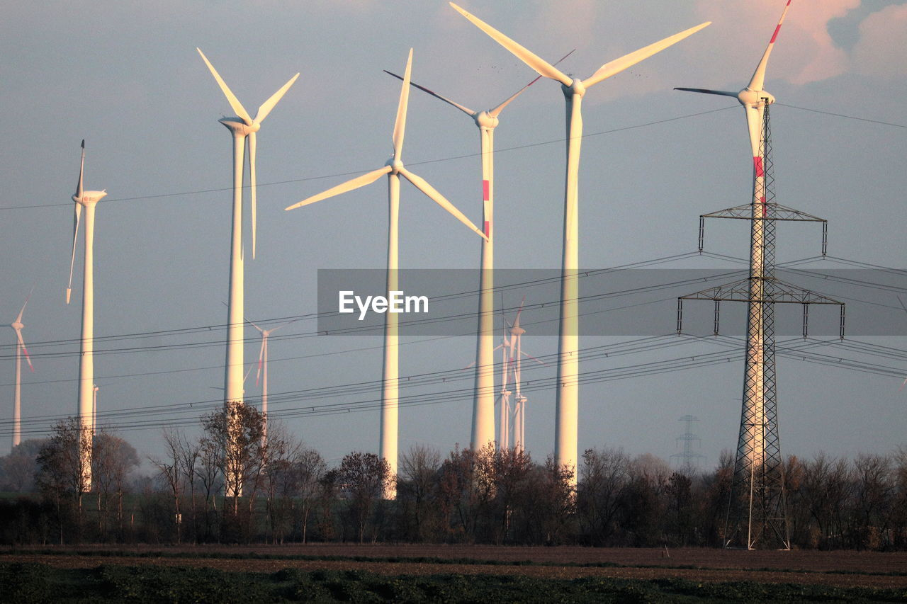 wind turbine, fuel and power generation, turbine, environment, wind power, environmental conservation, renewable energy, alternative energy, technology, sky, field, nature, landscape, land, no people, tree, electricity, plant, rural scene, outdoors, power supply, sustainable resources