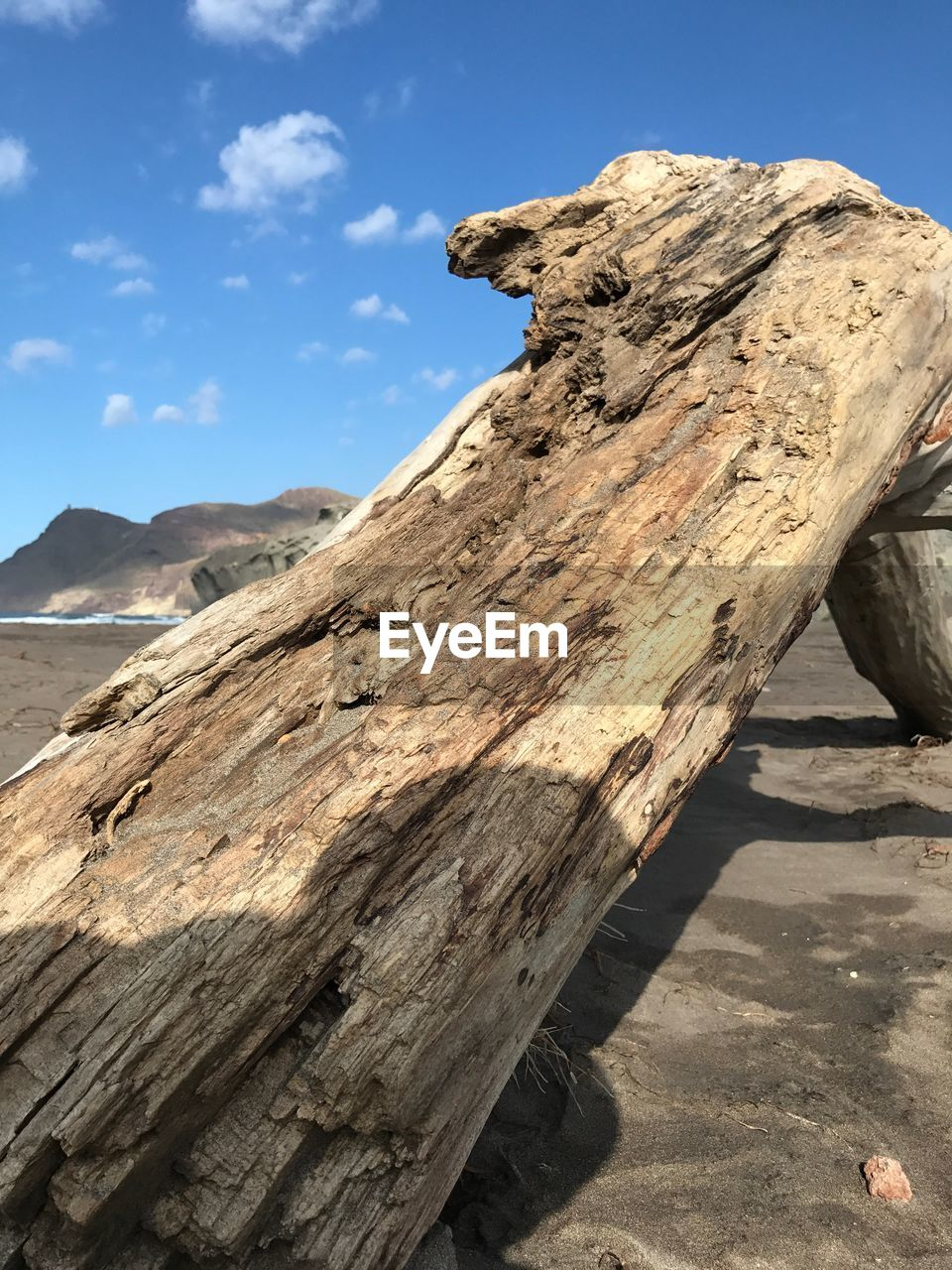 wood - material, sunlight, nature, outdoors, day, mountain, no people, shadow, sky, beauty in nature