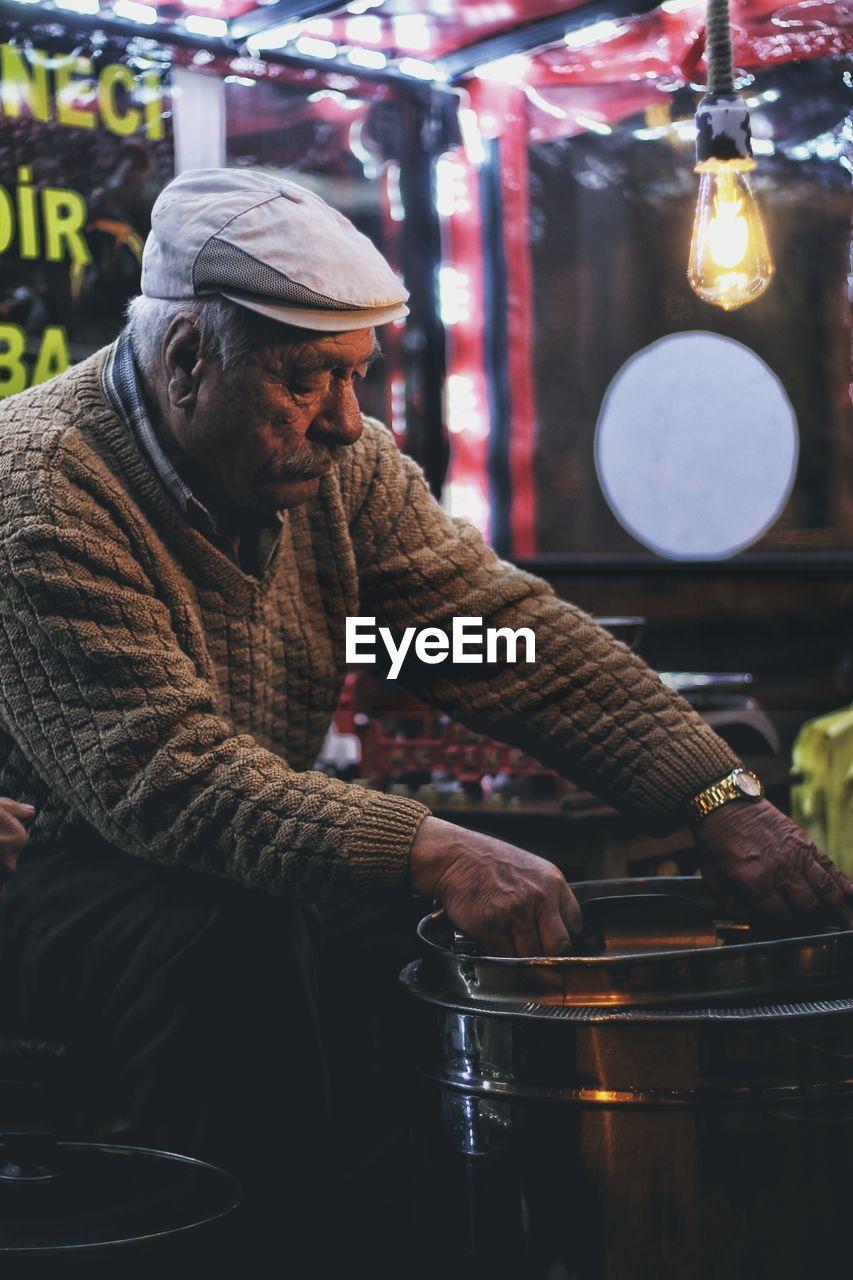 MAN HOLDING FOOD AT MARKET