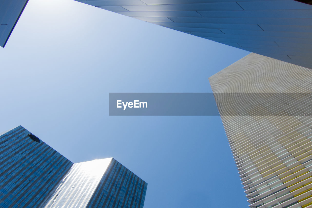 architecture, building exterior, built structure, building, office building exterior, city, low angle view, sky, modern, skyscraper, office, clear sky, tall - high, no people, day, nature, sunlight, blue, glass - material, outdoors, directly below, financial district