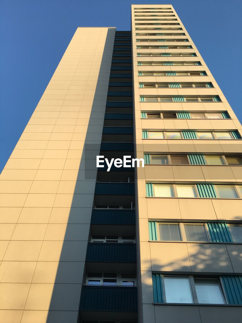 low angle view, architecture, building exterior, built structure, modern, no people, day, clear sky, outdoors, skyscraper, sky, city