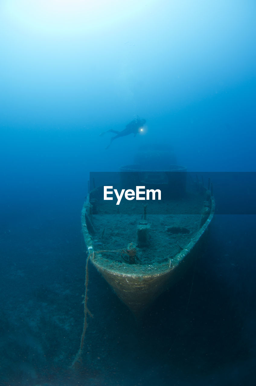 sea, underwater, undersea, water, exploration, nautical vessel, adventure, swimming, nature, scuba diving, transportation, sport, aquatic sport, beauty in nature, ship, mode of transportation, real people, outdoors, day, underwater diving, marine