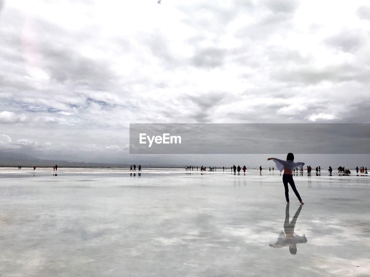 MEN PLAYING ON WATER AGAINST SKY
