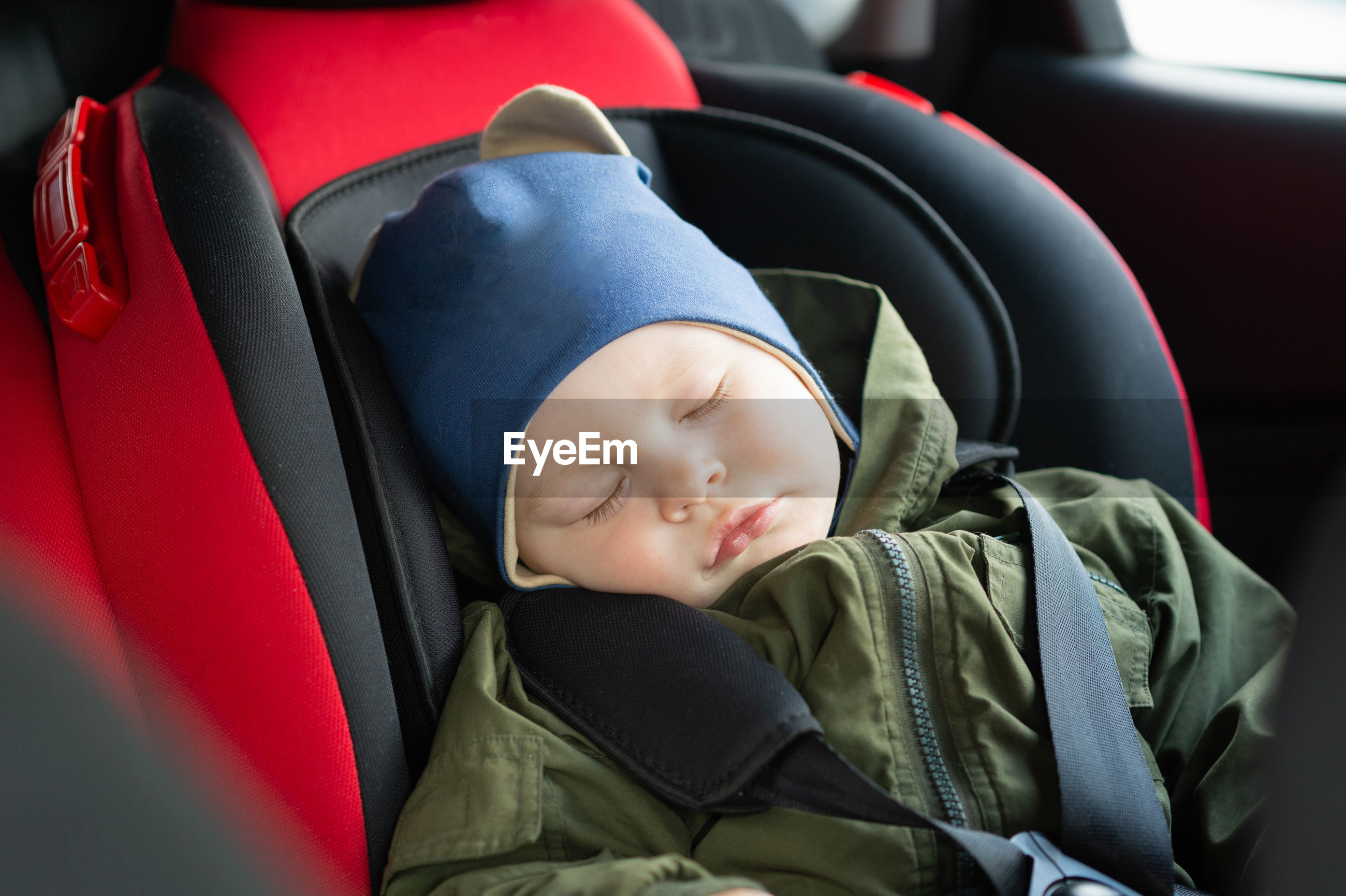 Cute baby boy sleeping in car