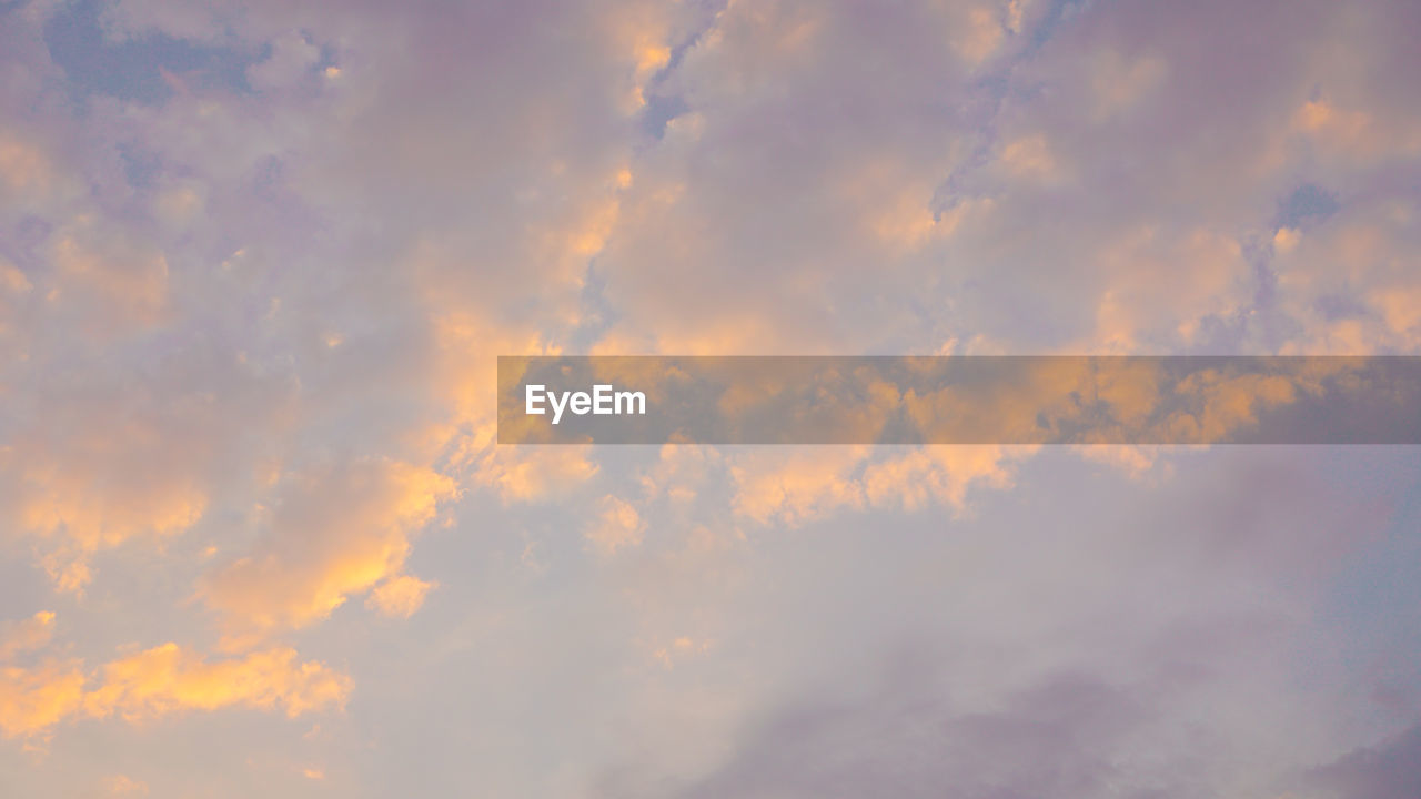 cloud - sky, sky, beauty in nature, low angle view, tranquility, scenics - nature, nature, no people, backgrounds, tranquil scene, full frame, outdoors, day, cloudscape, sunset, idyllic, dramatic sky, meteorology, orange color