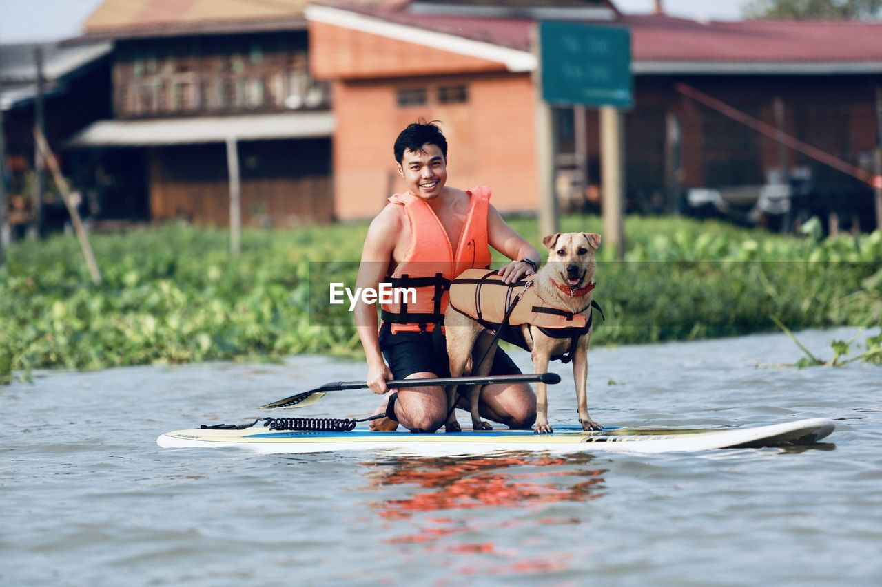 Man and dog on paddling