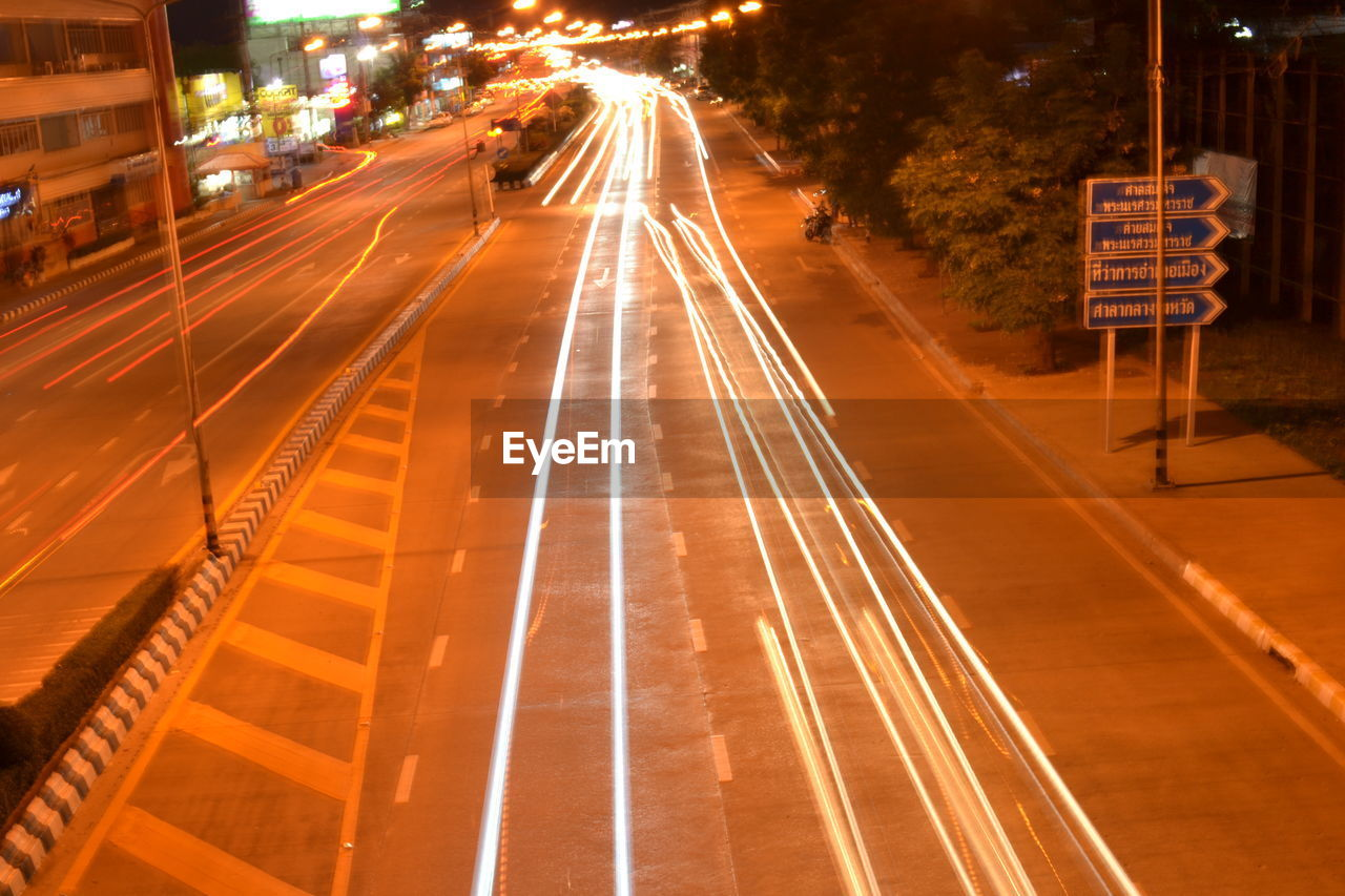 transportation, motion, long exposure, illuminated, light trail, night, speed, city, road, mode of transportation, architecture, sign, street, city life, high angle view, no people, blurred motion, direction, outdoors, traffic, track