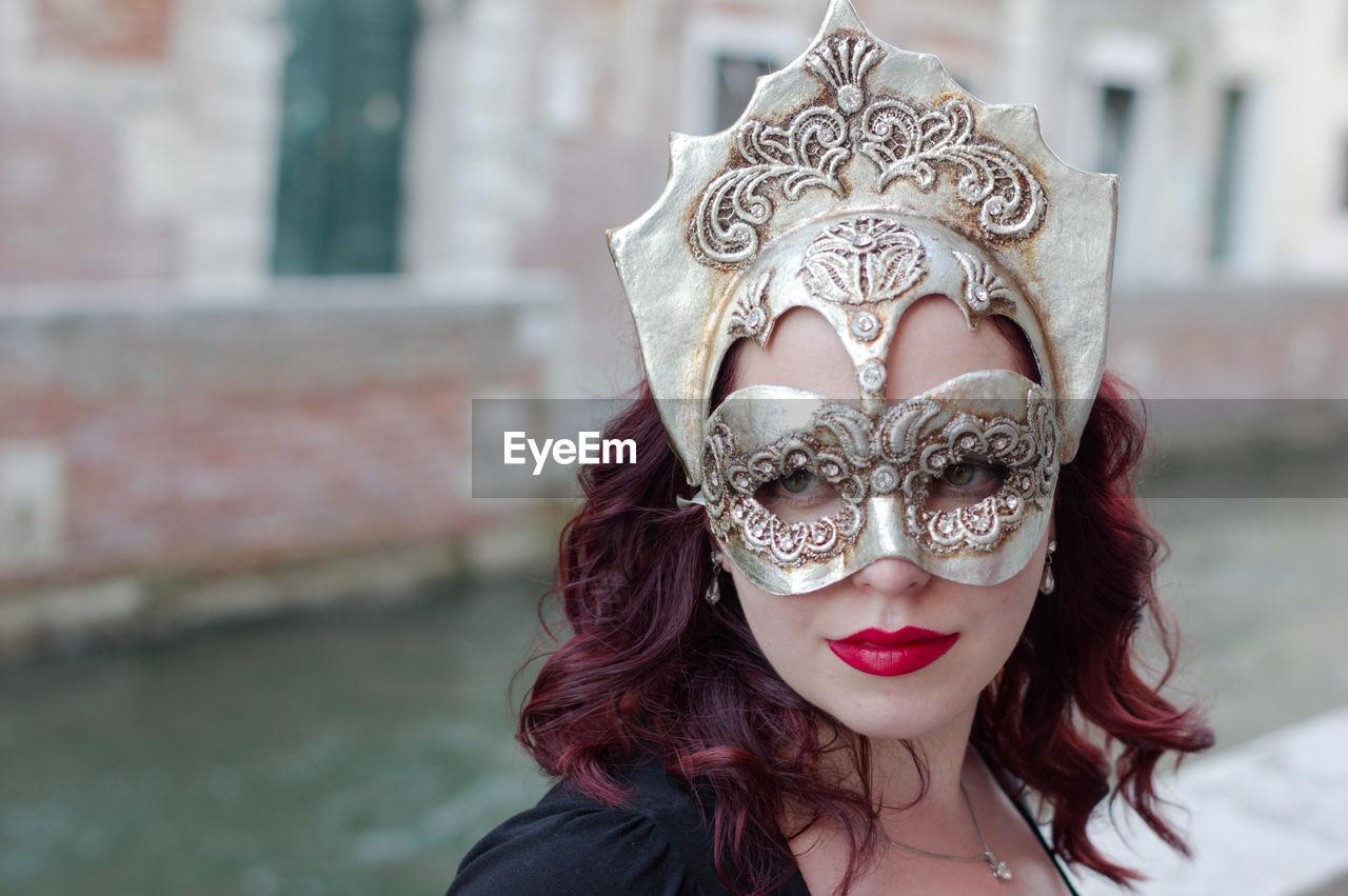 Close-Up Of Woman Wearing Venetian Mask