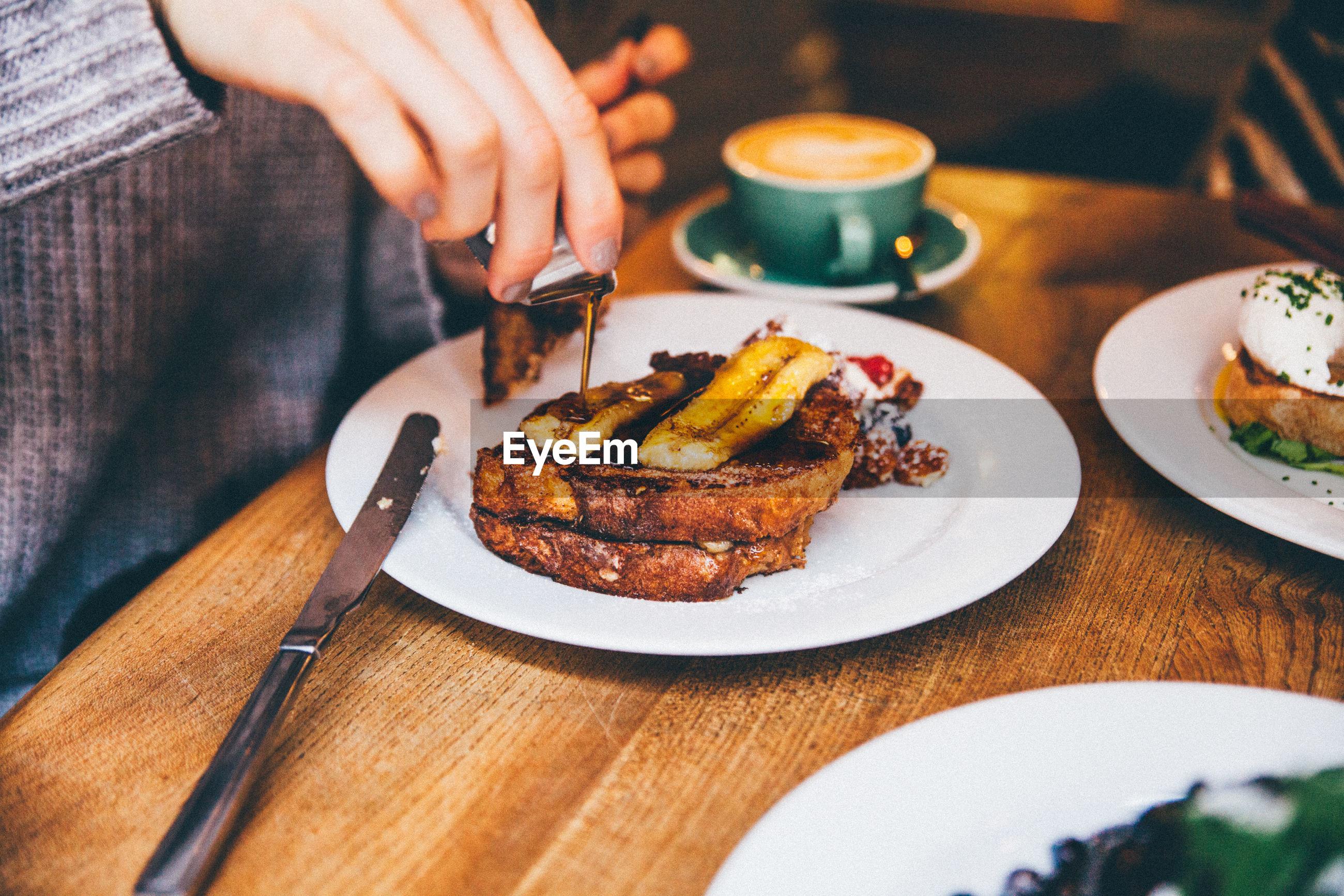 Close-up of woman having breakfast
