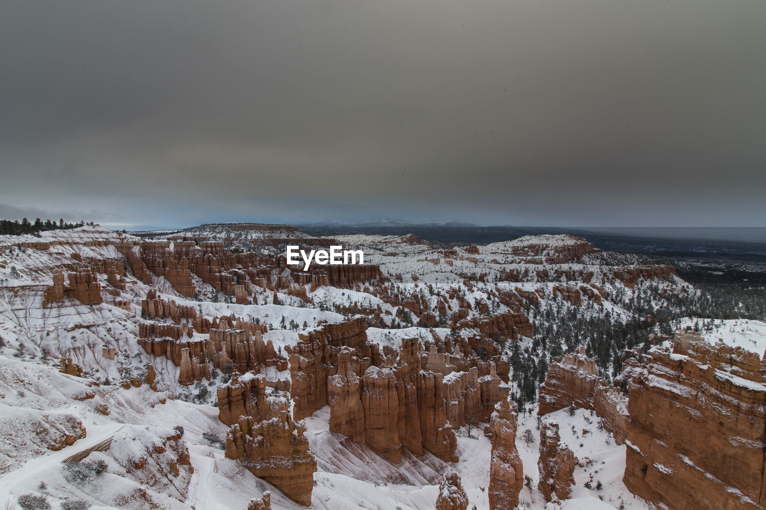 Rock formations against sky during winter