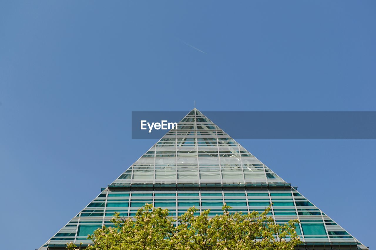 built structure, sky, architecture, clear sky, low angle view, building exterior, copy space, nature, blue, no people, day, building, plant, triangle shape, tree, shape, modern, outdoors, design, pyramid
