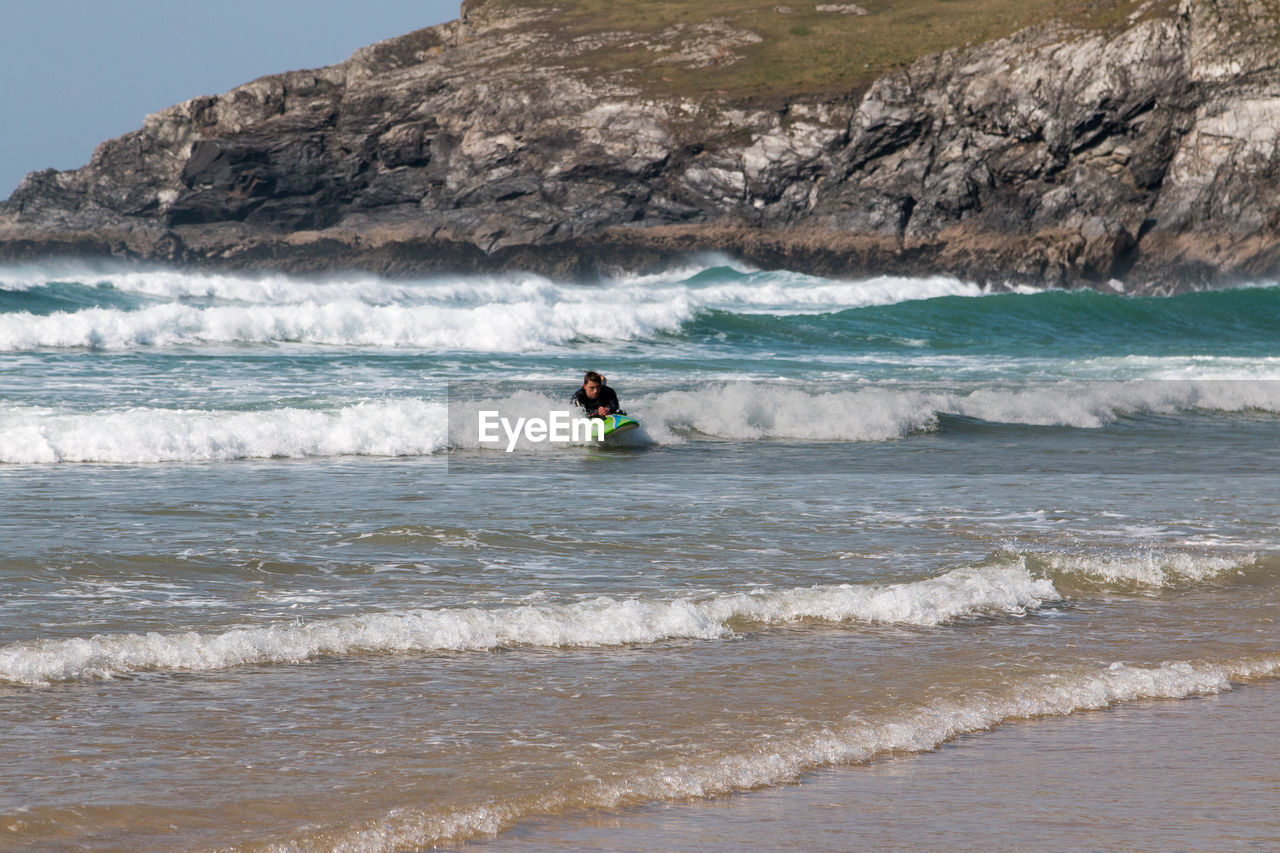 water, sea, sport, motion, wave, one person, land, beauty in nature, aquatic sport, adventure, surfing, leisure activity, beach, men, extreme sports, nature, day, lifestyles, outdoors, horizon over water