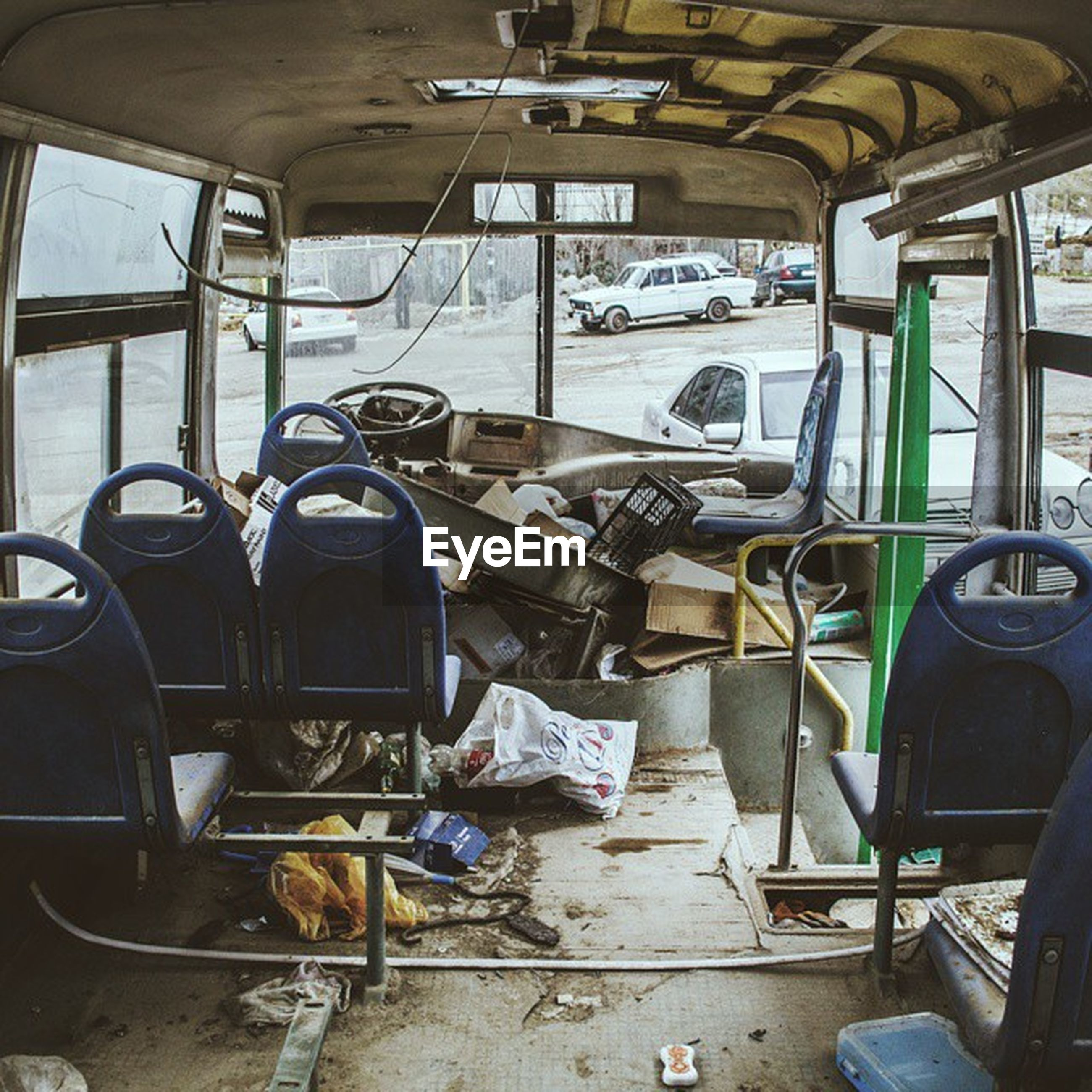 transportation, indoors, mode of transport, vehicle seat, vehicle interior, land vehicle, interior, absence, public transportation, train - vehicle, empty, chair, abandoned, travel, seat, window, car, obsolete, stationary, bus