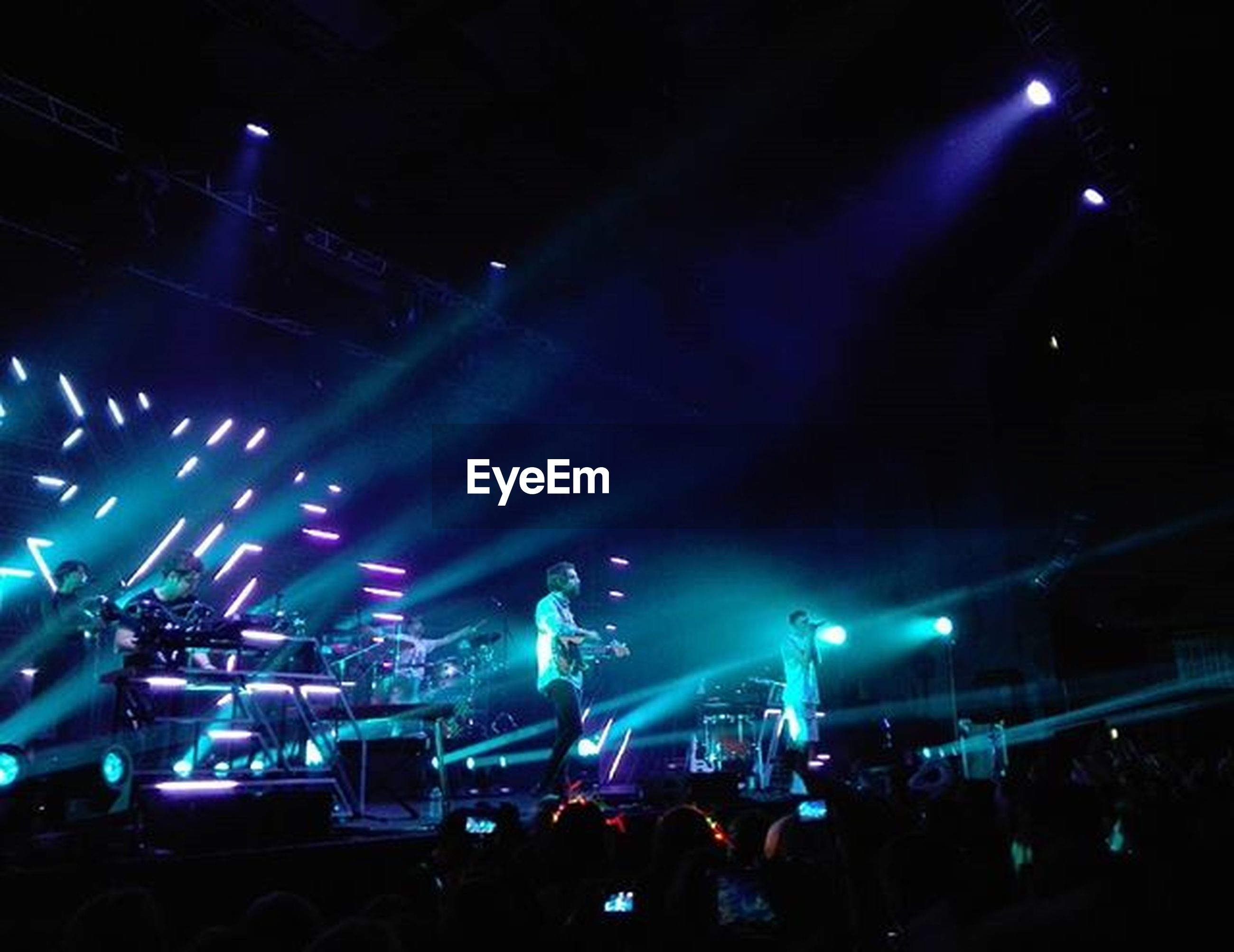 illuminated, night, large group of people, crowd, nightlife, lifestyles, music, arts culture and entertainment, person, men, leisure activity, event, enjoyment, performance, music festival, popular music concert, concert, lighting equipment