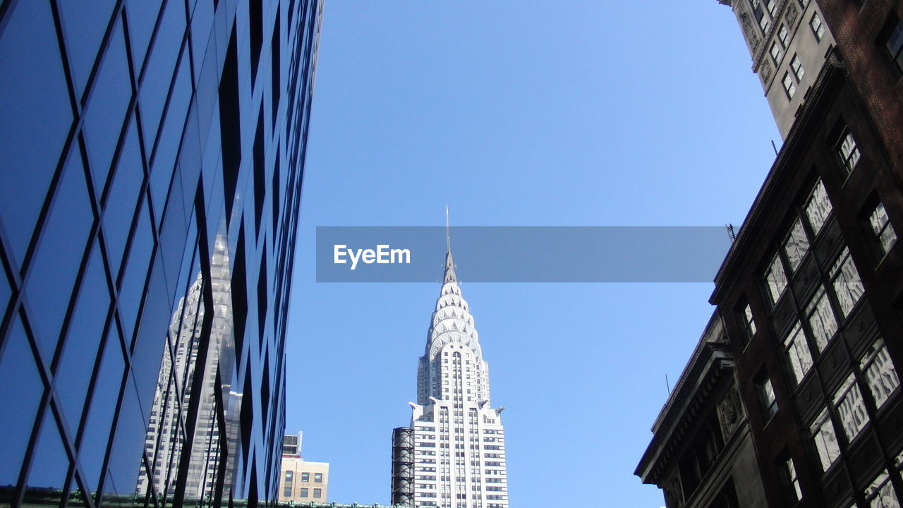 architecture, building exterior, built structure, clear sky, skyscraper, low angle view, tower, day, place of worship, no people, travel destinations, outdoors, city, sky, blue, tall, modern