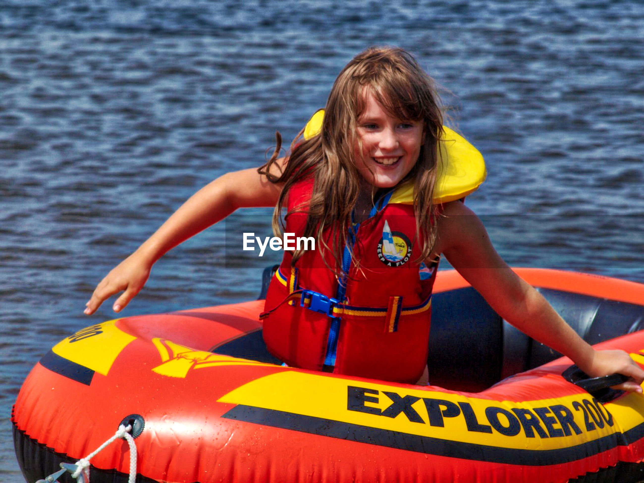 smiling, looking at camera, portrait, water, life jacket, nautical vessel, waist up, sea, front view, day, happiness, one person, blond hair, leisure activity, cheerful, outdoors, childhood, lifestyles, real people, oar, kayak, young adult, adult, people, adults only