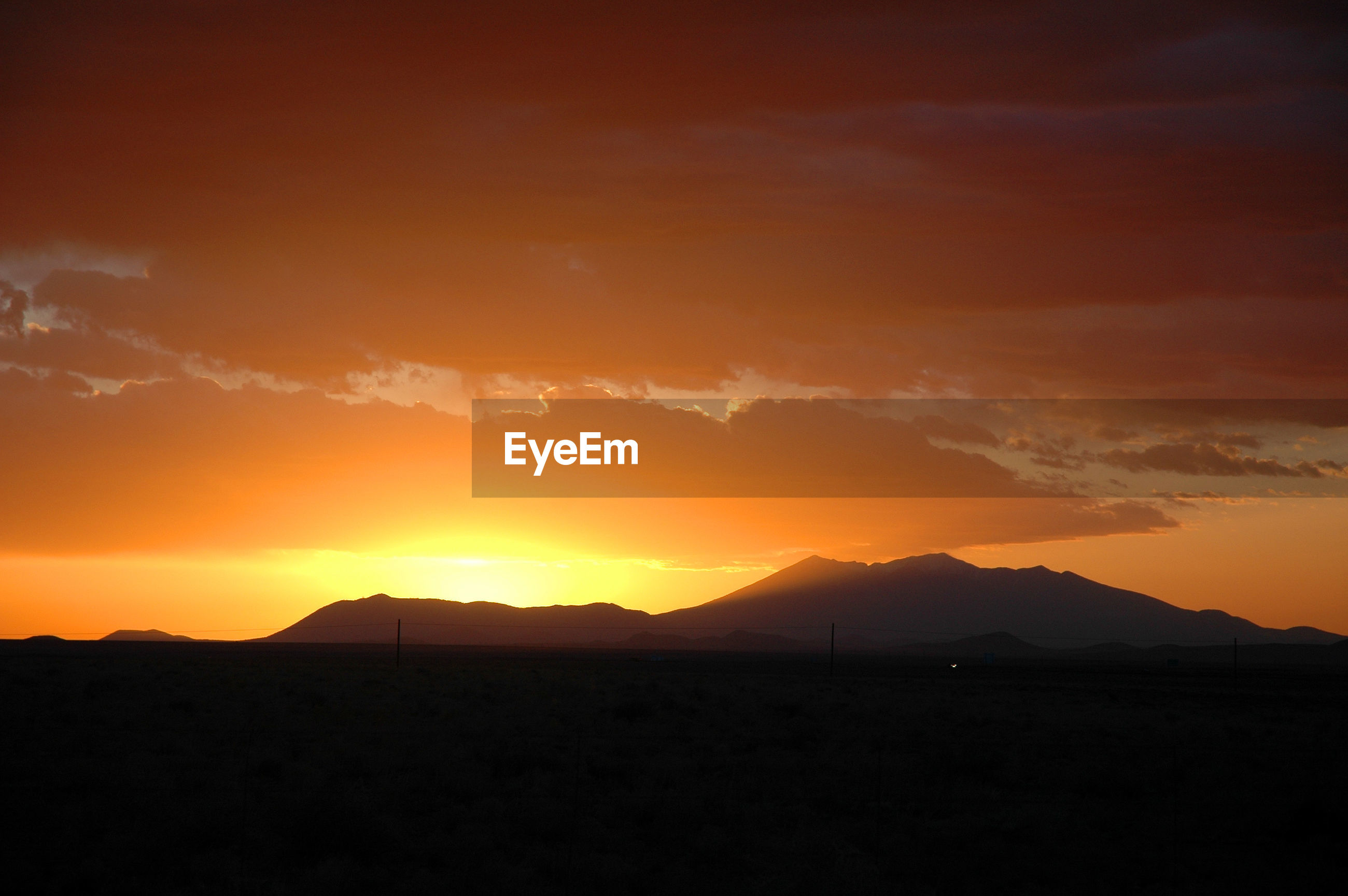 SCENIC VIEW OF SILHOUETTE MOUNTAINS AGAINST ROMANTIC SKY