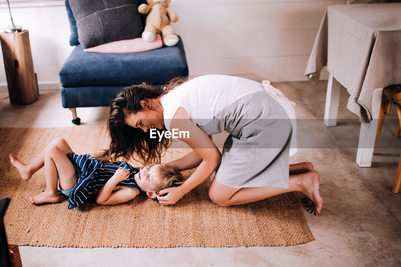 Woman relaxing on floor at home