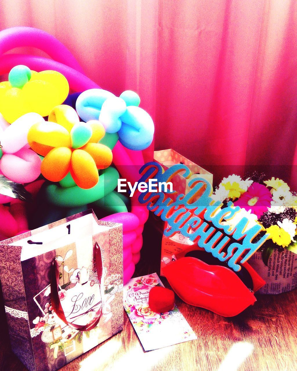 multi colored, celebration, indoors, gift, table, sweet food, no people, birthday, food, balloon, close-up, freshness, day