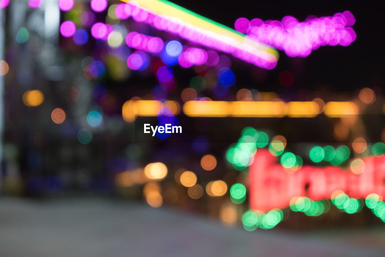 illuminated, night, glowing, multi colored, light - natural phenomenon, no people, defocused, city, pattern, lighting equipment, lens flare, geometric shape, circle, shape, architecture, design, outdoors, light, motion, city life, nightlife