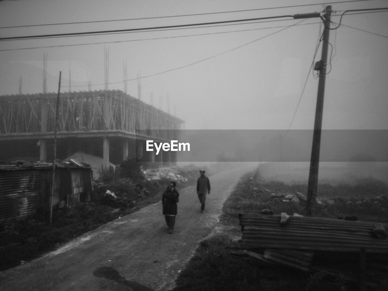 real people, cable, connection, built structure, outdoors, day, fog, architecture, sky, electricity pylon, men, bridge - man made structure, mountain, nature, full length, people