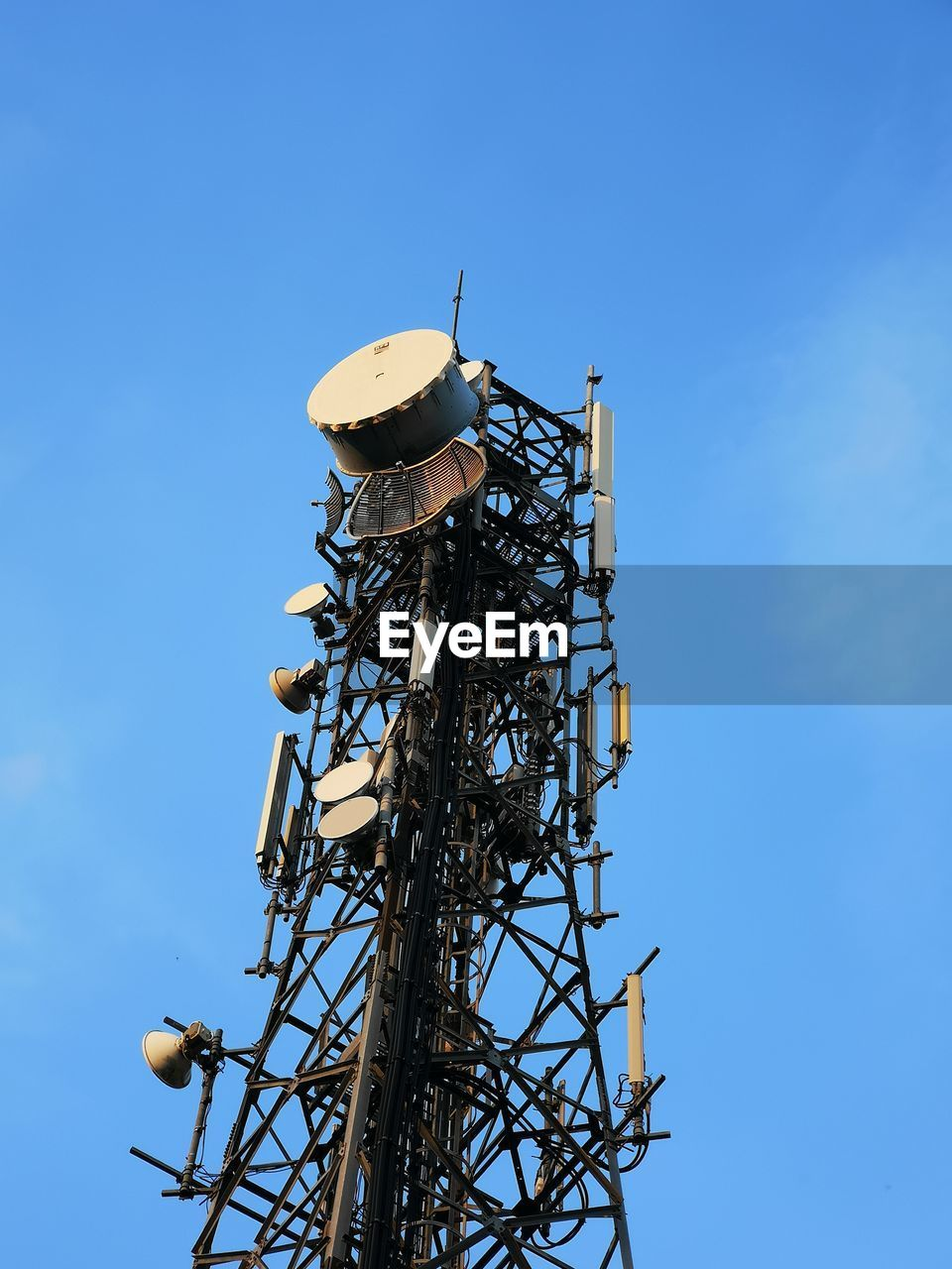 sky, low angle view, technology, tower, communication, global communications, no people, architecture, built structure, satellite, day, nature, connection, blue, antenna - aerial, tall - high, metal, satellite dish, broadcasting, wireless technology, outdoors, electrical equipment