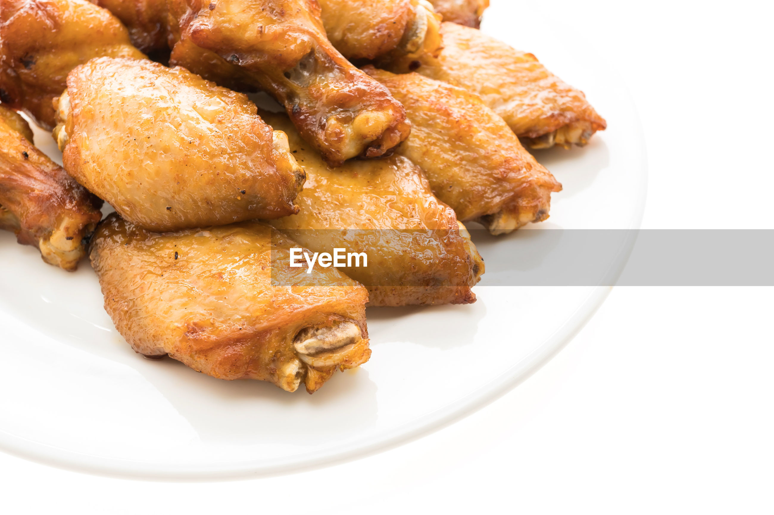 HIGH ANGLE VIEW OF BREAD IN PLATE ON WHITE BACKGROUND