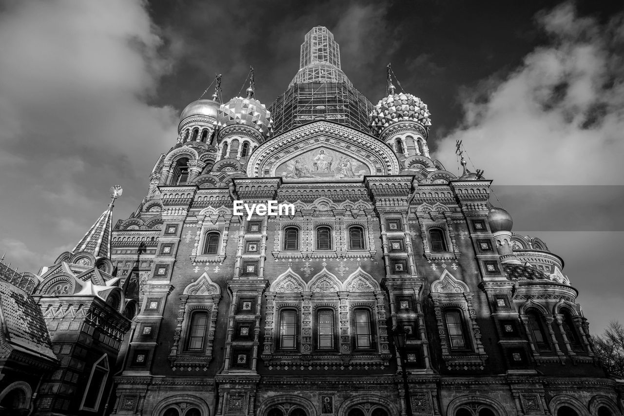 built structure, building exterior, architecture, low angle view, sky, cloud - sky, religion, travel destinations, building, belief, place of worship, spirituality, nature, travel, history, tourism, the past, no people, day, outdoors, ornate, gothic style, spire