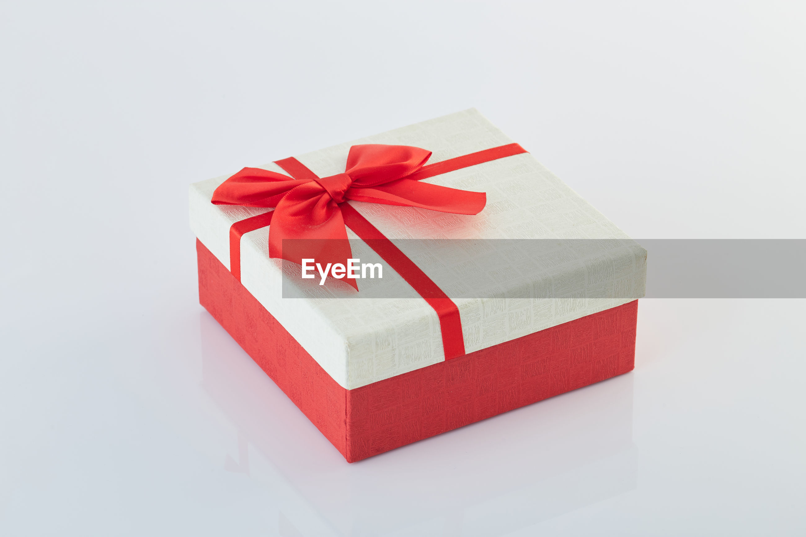 Close-up of gift box against white background