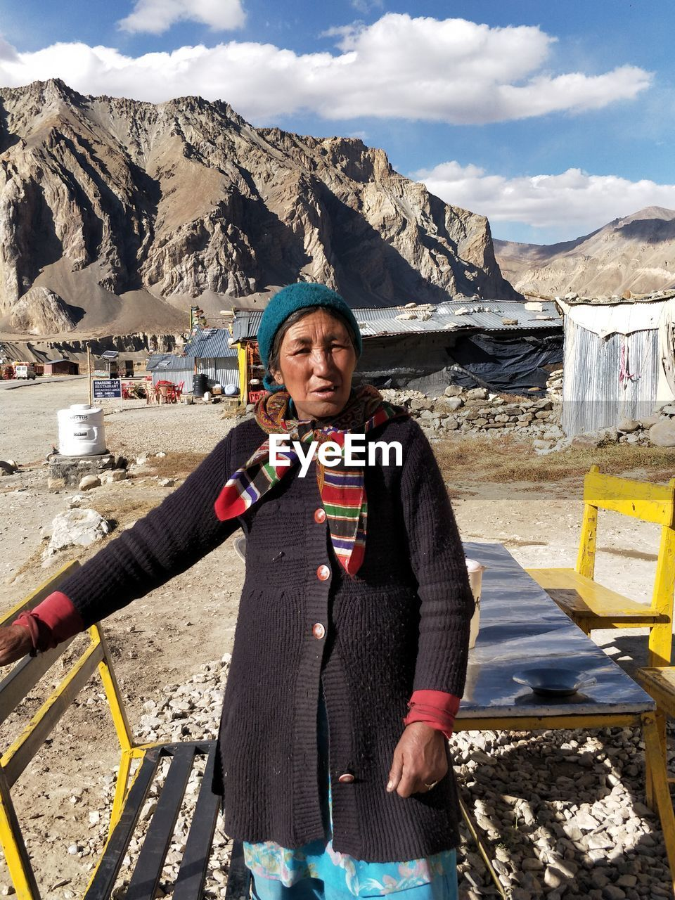 Senior Woman Standing Against Mountain