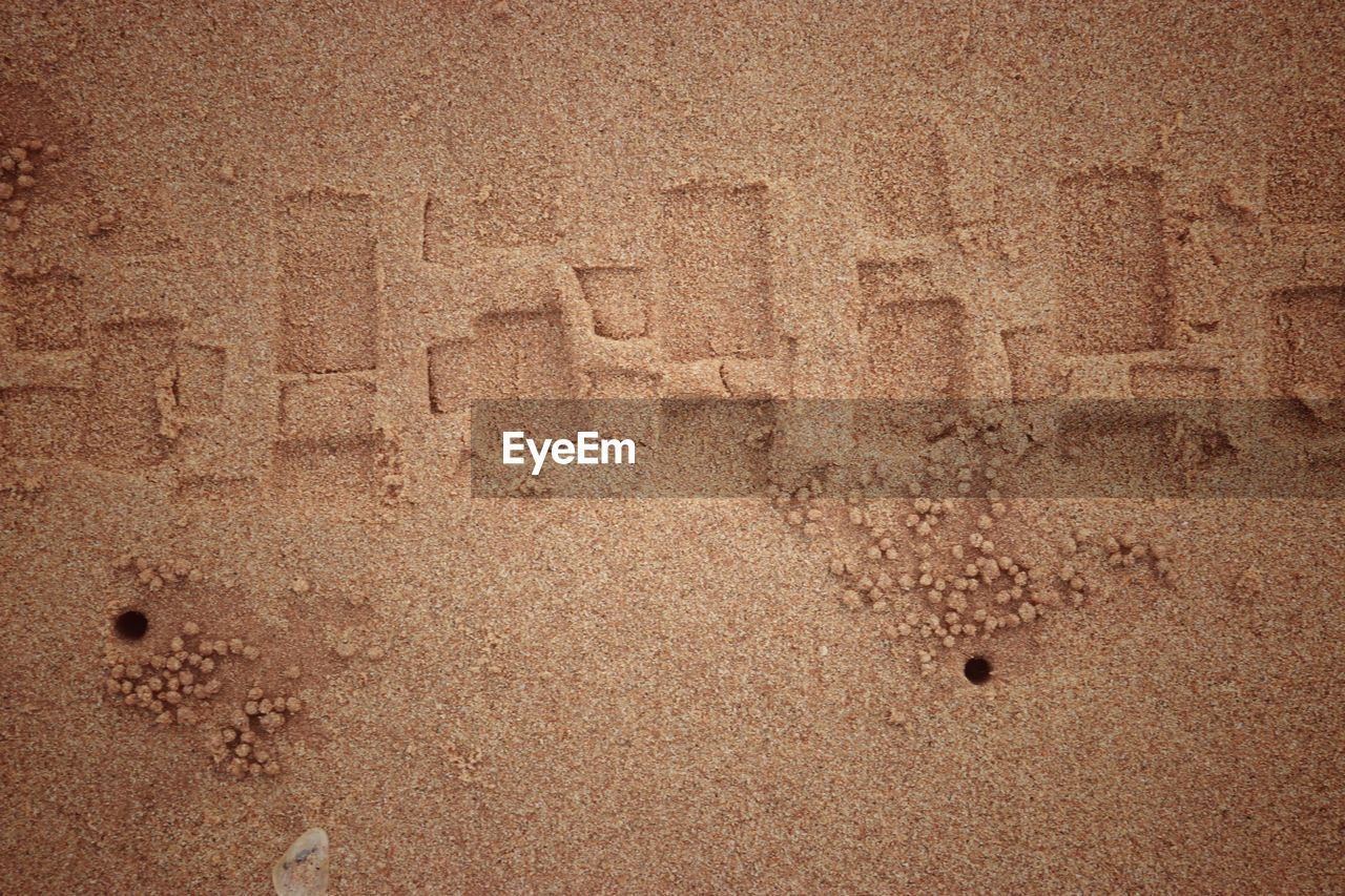 no people, brown, sand, backgrounds, full frame, pattern, beach, land, textured, day, art and craft, nature, close-up, outdoors, creativity, history, mystery, architecture, craft, wall