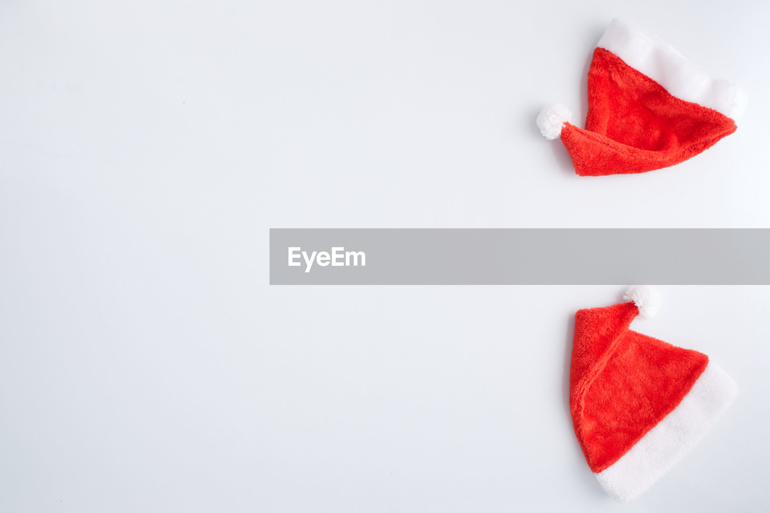 Close-up of santa hat against white background