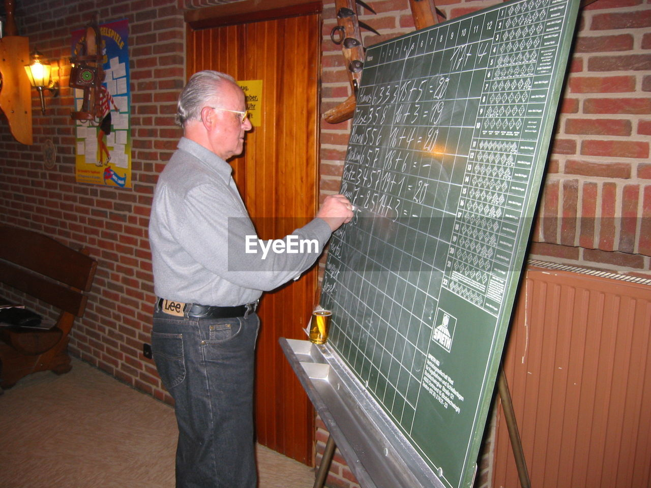 standing, men, occupation, males, adult, indoors, one person, three quarter length, mature adult, working, holding, industry, side view, senior adult, architecture, blackboard, senior men, mature men