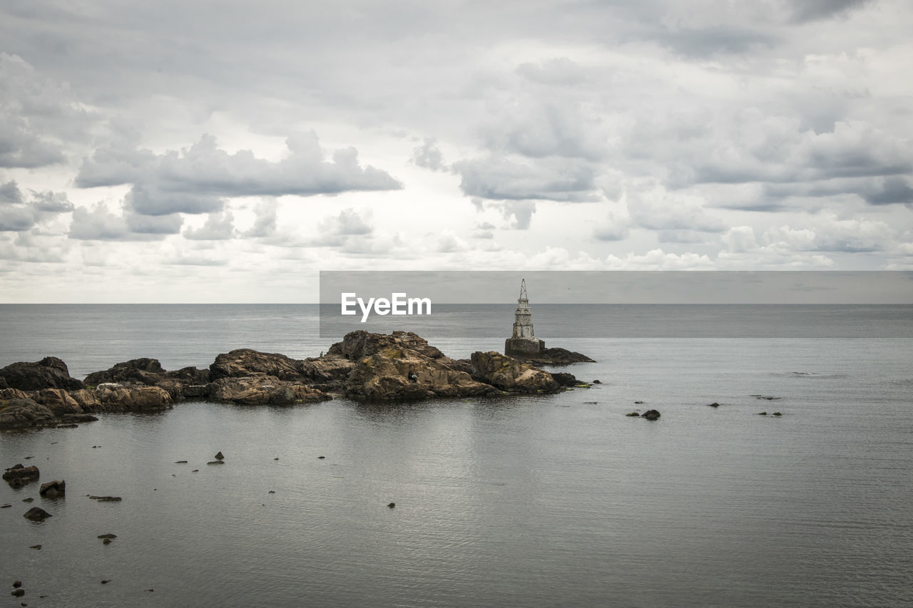 sea, water, sky, cloud - sky, beauty in nature, horizon, scenics - nature, horizon over water, tranquility, tranquil scene, waterfront, rock, nature, idyllic, rock - object, day, guidance, no people, architecture, outdoors, groyne