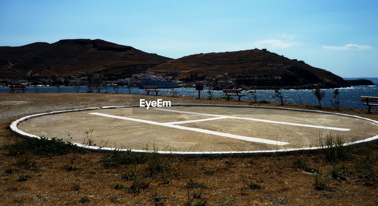 Helipad With Mountains In Background Against Sky