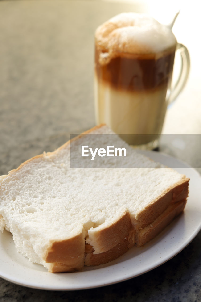 food and drink, food, coffee, drink, freshness, coffee - drink, refreshment, still life, cup, mug, coffee cup, bread, sweet food, plate, ready-to-eat, table, indulgence, close-up, hot drink, no people, meal, temptation, breakfast, crockery, snack