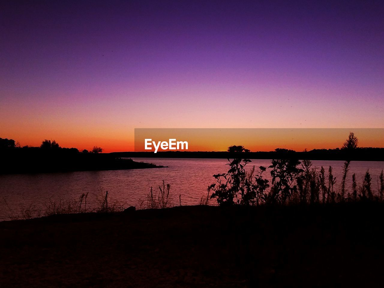 sunset, water, sky, silhouette, beauty in nature, tranquility, scenics - nature, tranquil scene, copy space, nature, lake, idyllic, beach, no people, orange color, clear sky, land, tree, outdoors, purple