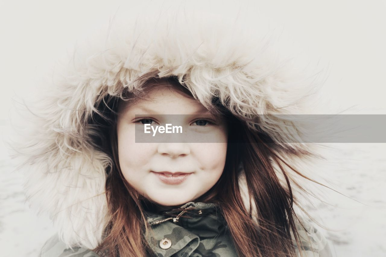 Portrait Of Smiling Girl In Warm Clothes