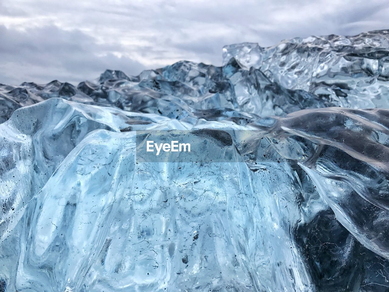 Close-Up Of Frozen Mountain Against Sky