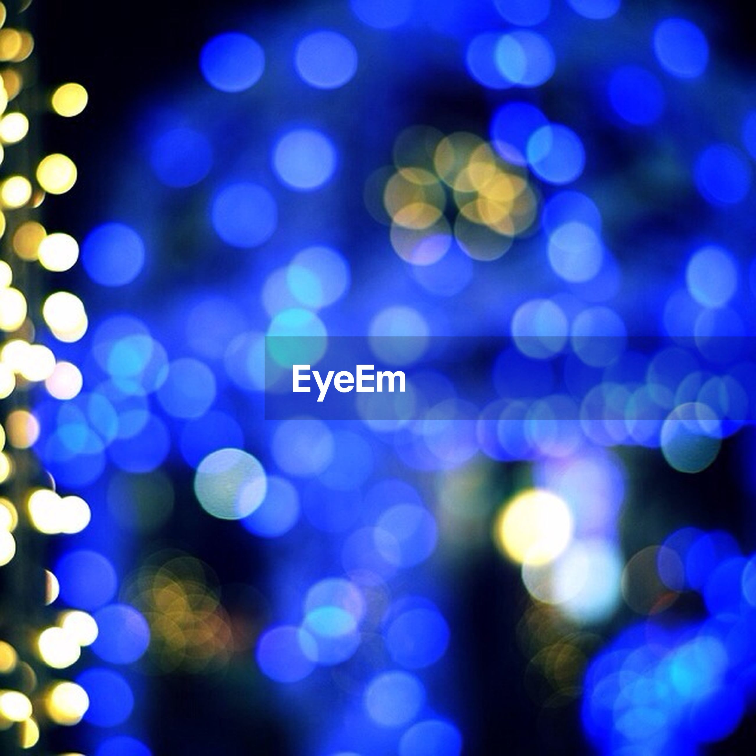 illuminated, multi colored, night, defocused, glowing, light - natural phenomenon, blue, lens flare, lighting equipment, colorful, celebration, abstract, no people, light, outdoors, backgrounds, selective focus, low angle view, close-up, light effect