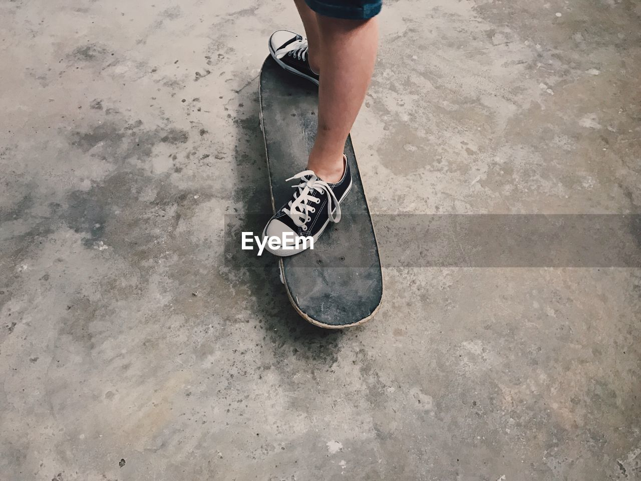 High Angle View Of Person Standing On Skateboard