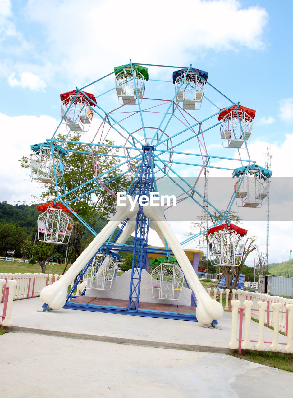 sky, cloud - sky, day, amusement park ride, amusement park, arts culture and entertainment, nature, outdoors, no people, metal, built structure, ferris wheel, playground, architecture, park, absence, low angle view, park - man made space, fairground, outdoor play equipment