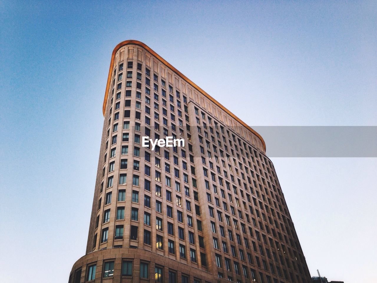 low angle view, architecture, building exterior, built structure, clear sky, skyscraper, day, modern, tall, outdoors, no people, city, sky