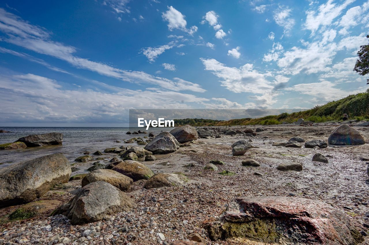 sky, cloud - sky, rock, tranquility, tranquil scene, beauty in nature, scenics - nature, water, rock - object, solid, land, nature, sea, no people, non-urban scene, day, plant, horizon, beach, outdoors, horizon over water, rocky coastline