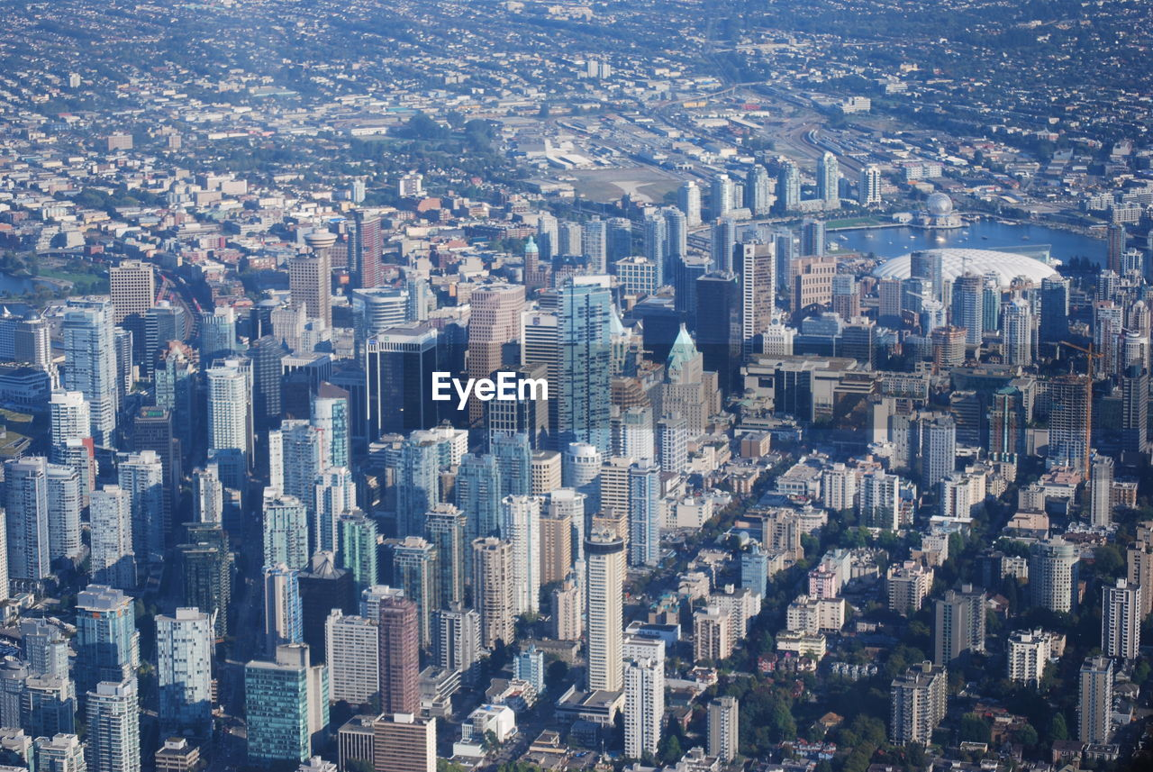 cityscape, city, building exterior, building, architecture, built structure, office building exterior, skyscraper, aerial view, crowd, residential district, modern, crowded, tall - high, high angle view, day, landscape, nature, outdoors, financial district, apartment