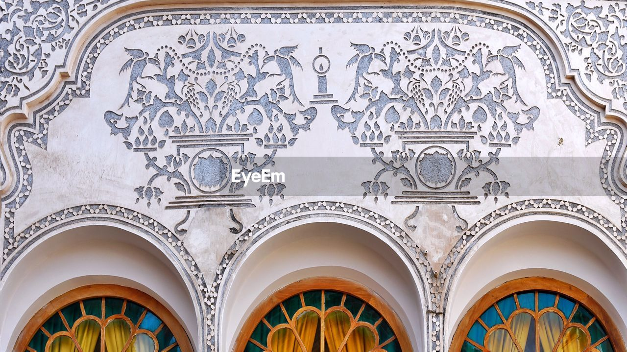 arch, architecture, built structure, low angle view, design, building exterior, no people, pattern, history, religion, belief, the past, place of worship, craft, spirituality, art and craft, building, ornate, floral pattern, mural, architectural column, architecture and art