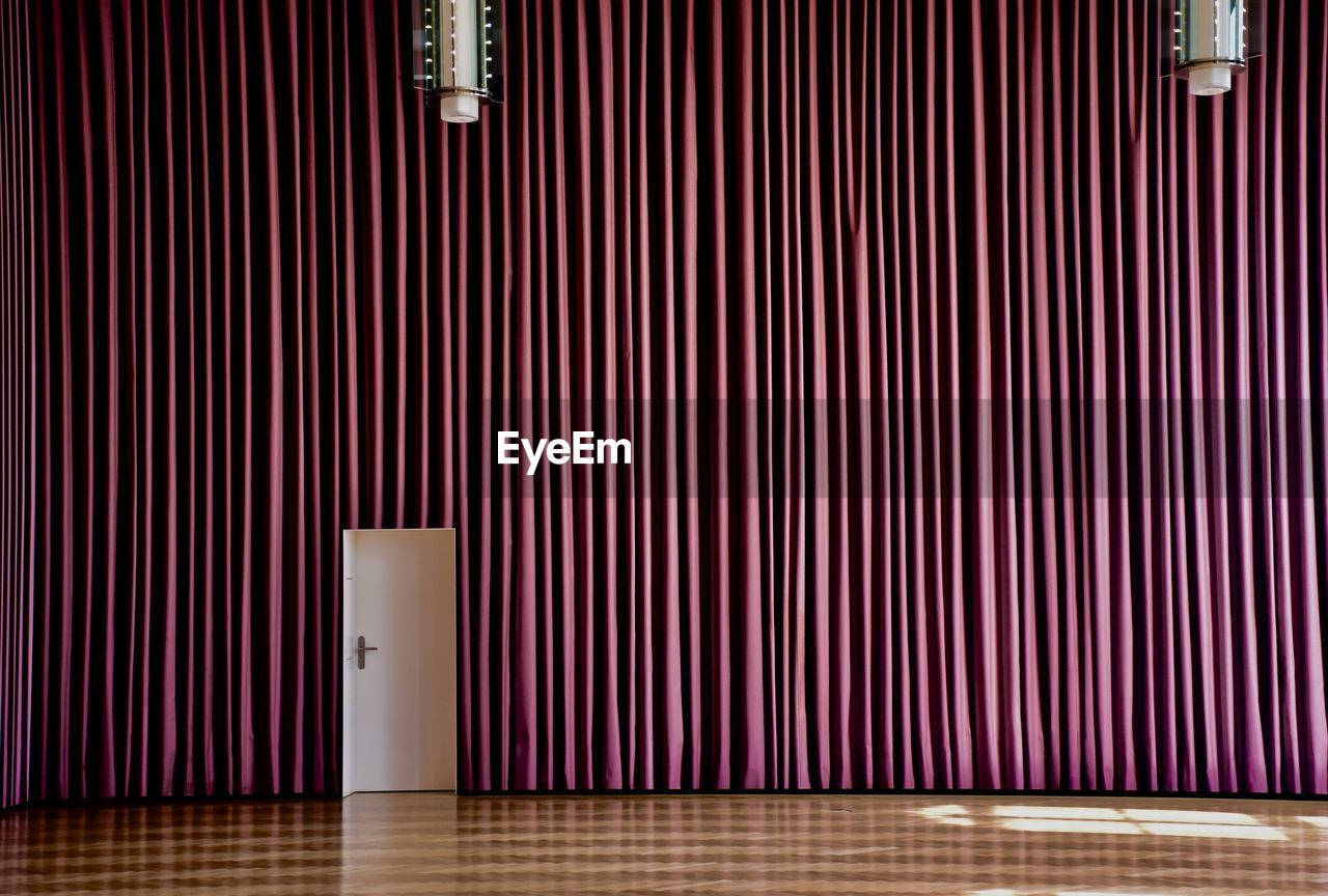Curtains on empty stage
