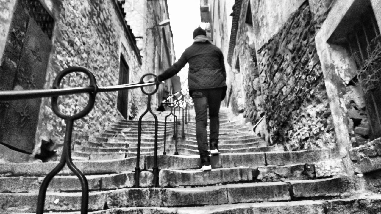 full length, one person, rear view, architecture, steps, steps and staircases, real people, built structure, railing, walking, casual clothing, day, outdoors, leisure activity, building exterior, men, one man only, adults only, only men, people, adult